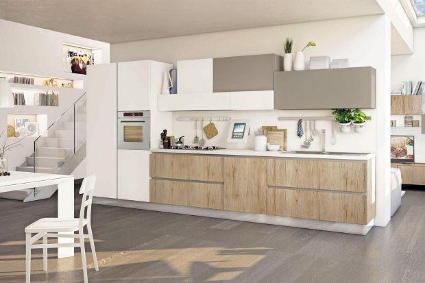 Biel optycznie rozjaśnia wnętrze, kolory drewna dodają mu przytulności i ciepła. Takie połączenie sprawi, że nasza kuchnia będzie ponadczasowa, nowoczesna, ale z nutą klasyki.