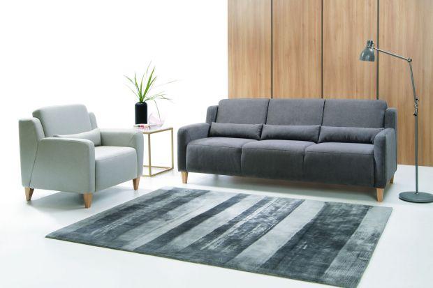 Sofa w salonie. Modne modele na wysokich nóżkach