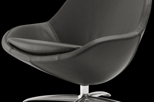 Veneto to elegancki obrotowy fotel o kubełkowatej formie.
