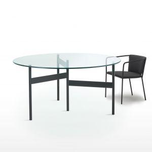 Stół Notes posiada minimalistyczny w formie okrągły blat, wykończony cementem, drewnem lub szkłem. Living Divani