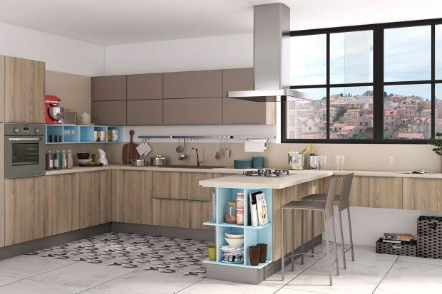 Jasne odcienie drewna zastosowane w zabudowie kuchennej sprawiają, że wnętrze staje się ciepłe, przytulne i pełne światła. Wygląda naturalnie i ponadczasowo.