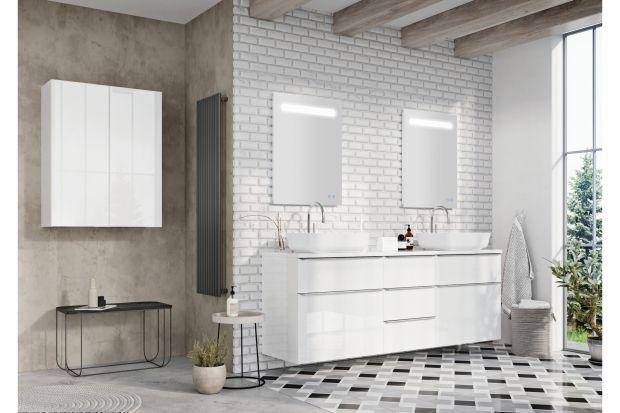 """W białej łaziencepanuje przyjemny, nieco chłodny i """"orzeźwiający"""" klimat. Ten kolorjest wręcz dedykowany pomieszczeniom, które służą do czynności higienicznych, a tym samym lubią czystość formy i jasne, świetliste kolory."""