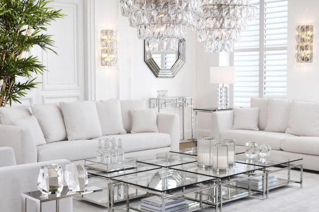 Biel, srebro, jasne, rozbielone odcienie szarości i pastelowych kolorów podkreślają subtelny wdzięk wnętrz w stylu glamour. Urządzając salon w tym klimacie, warto postawić na meble ze szkła, metalu lub jasnego drewna.