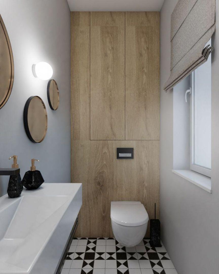 Oszczędny wystrój ubikacji na parterze urozmaica podłoga z biało-czarnej mozaiki oraz trzy lustra o różnych średnicach, które rozmieszczono w nieregularnych odstępach nad umywalką. Wraz z kinkietami tworzą dekorującą wnętrze kompozycję. Projekt: Małgorzata Górska-Niwińska (Pracownia Architektoniczna MGN).