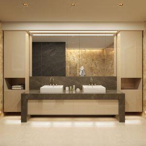 Naturalny kamień sprawdzi się także w łazience - równie dobrze jako blat, jak też na przykład szafka podumywalkowa. Fot. Interstone