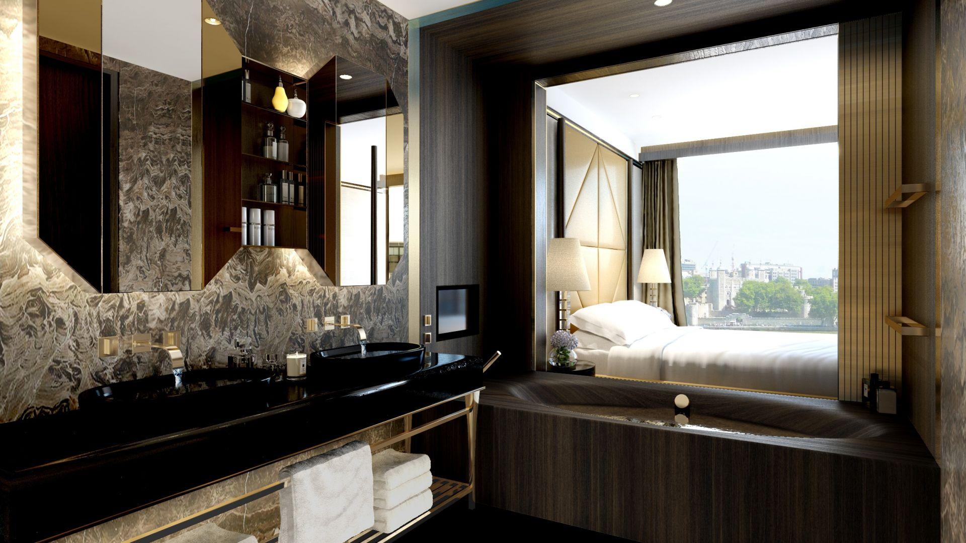 Wielką zaletą części apartamentów są oszałamiające widoki - na Tamizę i centrum Londynu. W tej łazience wykorzystano drewno habanowe.