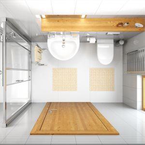 Duża kabina w małej łazience daje poczucie przestrzeni podczas kąpieli. Umywalkę i sedes warto zainstalować na stelażach podtynkowych, bo po zabudowaniu ich powstają praktyczne półki. To wnętrze z wyposażeniem Spark marki Koło. Fot. Koło