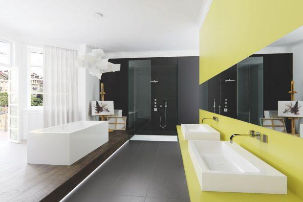 Nawet, gdy ściany naszej łazienki mają stonowane odcienieszarości, bieli lub beżu, możemy dodać wnętrzuwesołego charakteru, wprowadzając różnobarwne dekoracje lub praktyczne akcesoria.