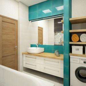 Pomysł na pralkę we wnęce: miejsce nad pralką zostało praktycznie wykorzystane na półki na czyste ręczniki oraz chemię domową.Na zdj. bateria Cynia oraz umywalka Peonia Deante. Fot. Deante