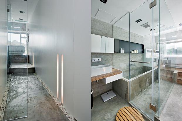 Nowoczesna łazienka w betonie i szkle sąsiaduje bezpośrednio z sypialnią, od której oddziela ją jedynie tafla szkła. Zobaczcie niesamowity projekt!