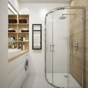 Półokrągła kabina prysznicowa w narożniku małej łazienki. Fot. Sanplast