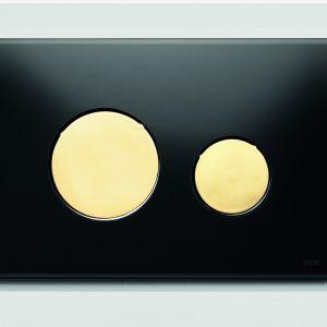 Szklany przycisk spłukujący TECEloop ze złotymi klawiszami; wymiary: 150x220 mm; cena netto: 1.097 zł