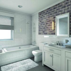 Ścianę w łazience wykończono ręcznie formowanymi płytkami ceglanymi Nevado. Fot. CRH Klinkier