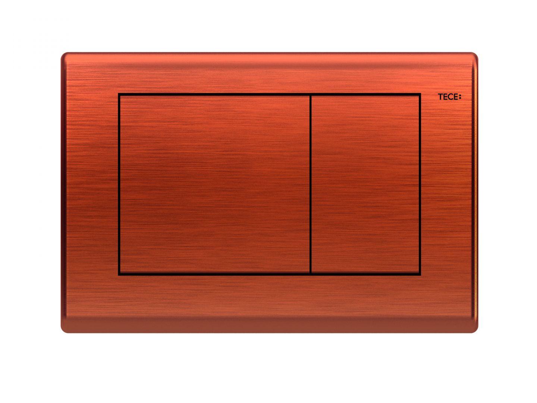 Przycisk spłukujący TECEplanus w kolorze antyczna miedź. Fot. TECE