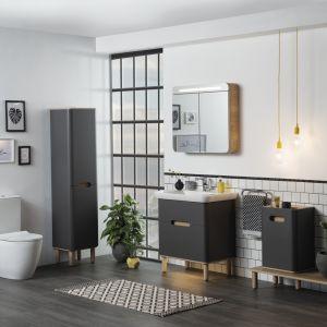 Sento – kolekcja mebli, w której skład wchodzą m.in. rozwiązania do przechowywania środków czystości oraz moduł do umieszczenia w nim pralki wraz z koszem na pranie; z otworami wentylacyjnymi. Fot. VitrA
