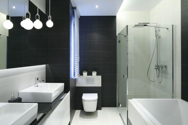 Urządzając strefę prysznica w łazience warto zaplanować ją w narożniku pomieszczenia. Dzięki temu nie zajmie zbyt wiele miejsca.