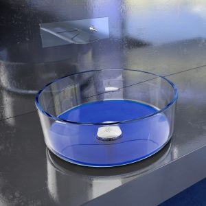 Szklana umywalka nablatowa z kolekcji Drop Katino w kolorze Blue. Fot. Glass Design