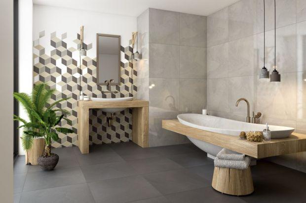 Uniwersalna kolorystyka bazująca nabeżach i szarościach połączona z geometrycznymi motywami to pomysł na ponadczasową, ale nowoczesną łazienkę.