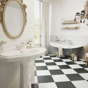 Biała łazienka z bateriami z serii Retro New. Fot. Ferro