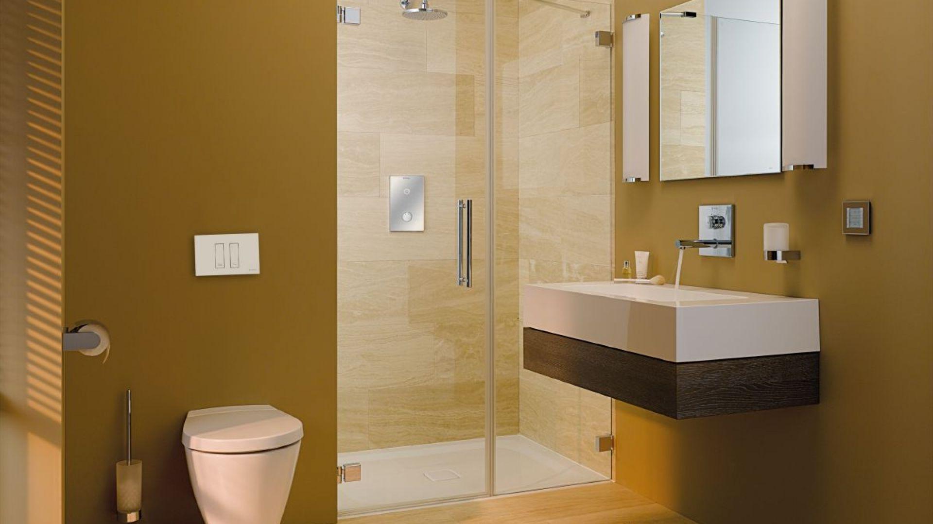 Aranżacja nowoczesnej łazienki z przyciskiem spłukującym Tower. Fot. Schell