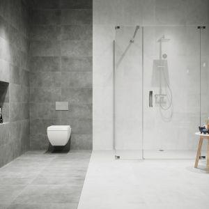 Możemy także pobawić się kolorem. Wówczas tzw. strefa mokra - zarówno podłoga, jak i ściany, powinna wyraźnie odcinać się od reszty pomieszczenia lub powierzchni bezpośrednio z nią sąsiadującej. Taki efekt uzyskamy wybierając kolekcję Apenino w wersji bianco i antracyt. Fot. Cerrad