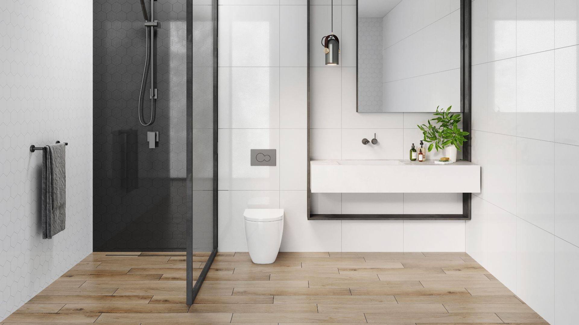 Flementy heksagonalne z kolekcji Cambia w kolorze white oraz black doskonale uzupełnią dwie ściany otwartego prysznica. Fot. Cerrad