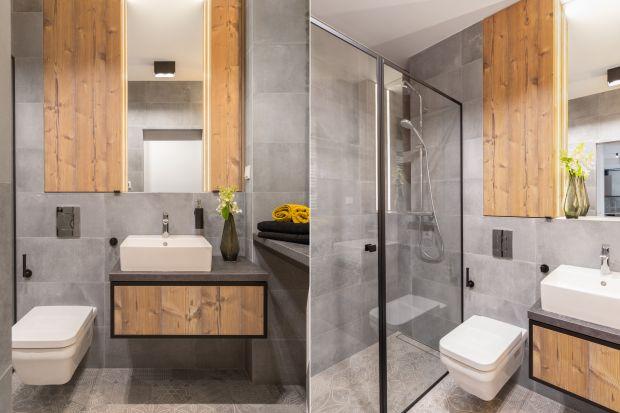 Szara łazienka w stylu loft zyskała nietuzinkowy charakter za sprawą pochodzącej z rozbiórki starej cegły, metalowych ram i drewnianych akcentów. Zobacz gotowy projekt!