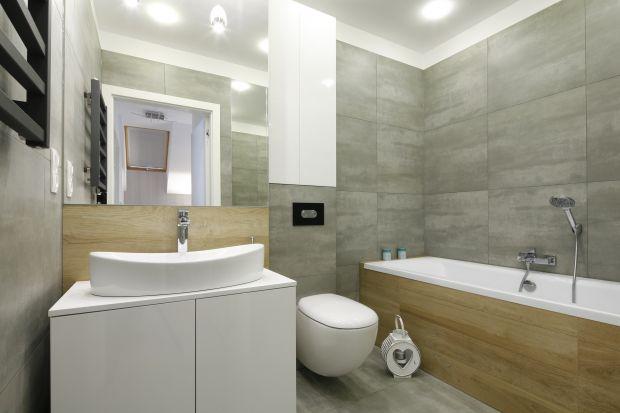 Połączenie szarości i motywów drewna to elegancki i ponadczasowy sposób na aranżację łazienki. Zobacz jak zrobili to inni.