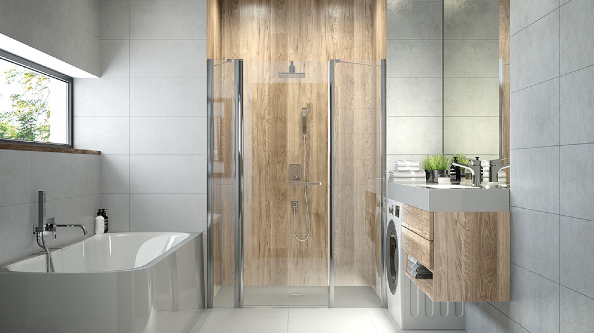Aranżacja łazienki z jasnoszarym brodzkiem. Fot. Sanplast