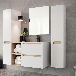 STILLA nawiązuje do skandynawskiego designu.  Białe, lakierowane na wysoki połysk szafki, z dekoracyjnymi blendami w kolorze buku truflowego, pięknie odbijają światło. Dostępne w ofercie firmy Ø NAS. Fot. Ø NAS
