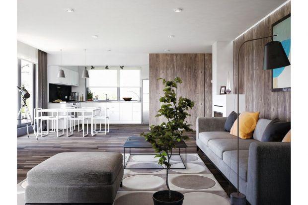 Jasne wnętrze domu ocieplone drewnem
