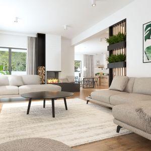 W części salonowej domu wszystko podporządkowane jest relaksowi. Atmosferze wyciszenia sprzyjają łagodne barwy z palety kolorów ziemi. Fot. Inspirium
