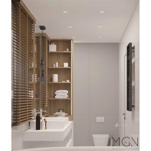 W wiszącym regale, szafce podumywalkowej i schowkach nad instalacją podwieszonego sedesu jest dużo miejsca do przechowywania – uroda w tej łazience idzie w parze z funkcjonalnością. Fot. Pracownia MGN