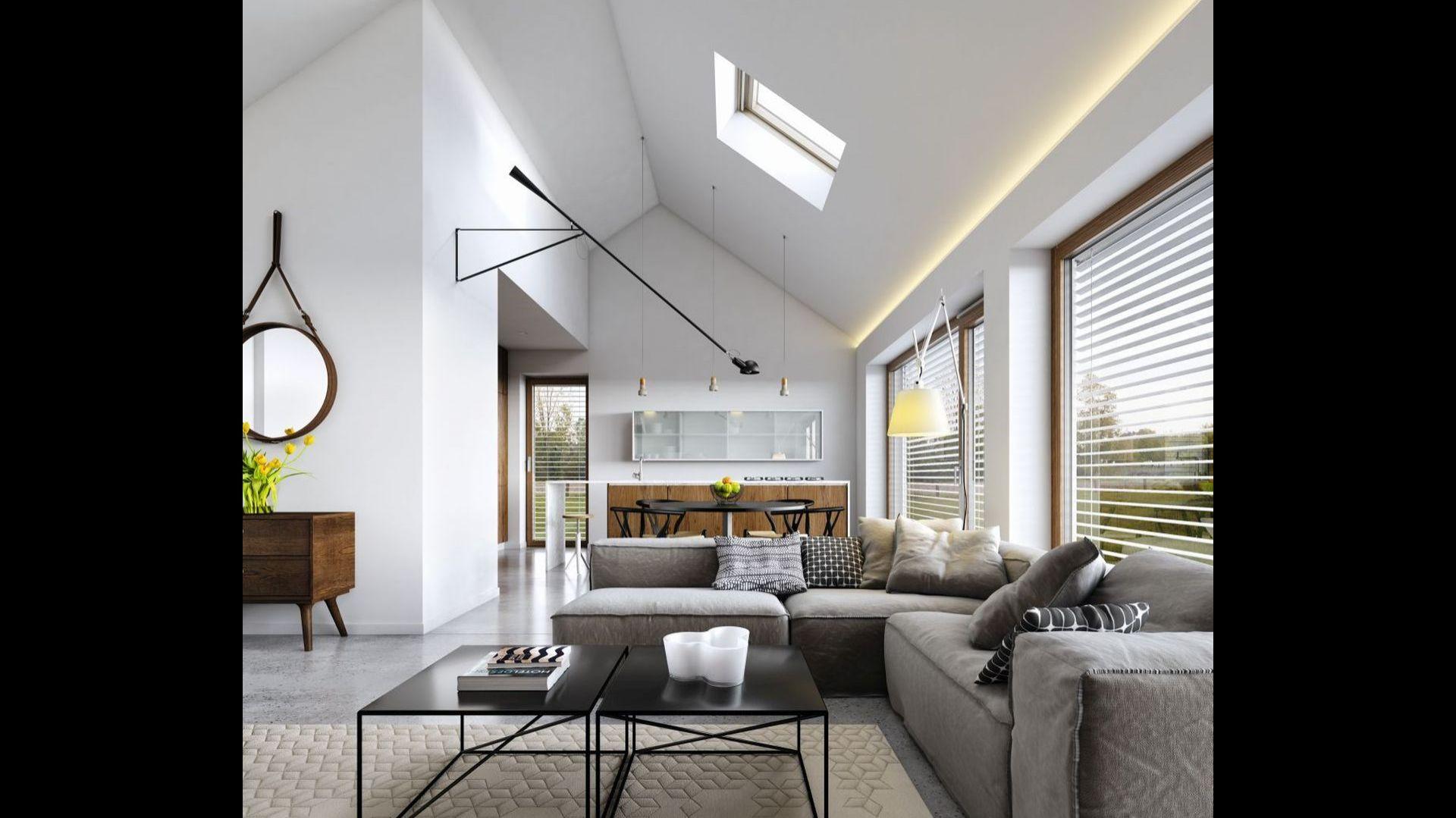 Otwarta kuchnia połączona z jadalnią i salonem zyskuje na przestronności dzięki otwarciu po sam dach. Fot. Domy z Wizją