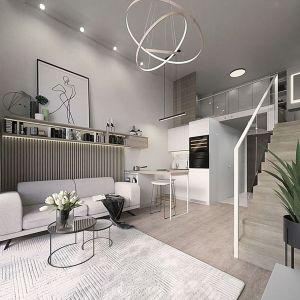 Salon z aneksem kuchennym to najlepszy skuteczny sposób na stworzenie rodzinnej przestrzeni. Proj. Lena Interiors. Fot. Homebook