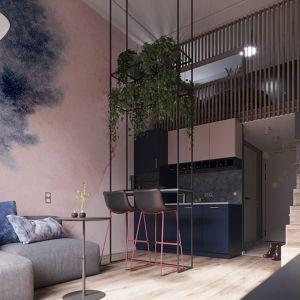 Efekt spójności w salonie z aneksem kuchennym można uzyskać poprzez zastosowanie tych samych lub współgrających ze sobą materiałów wykończeniowych. Projekt: Poco Design. Fot. Homebook