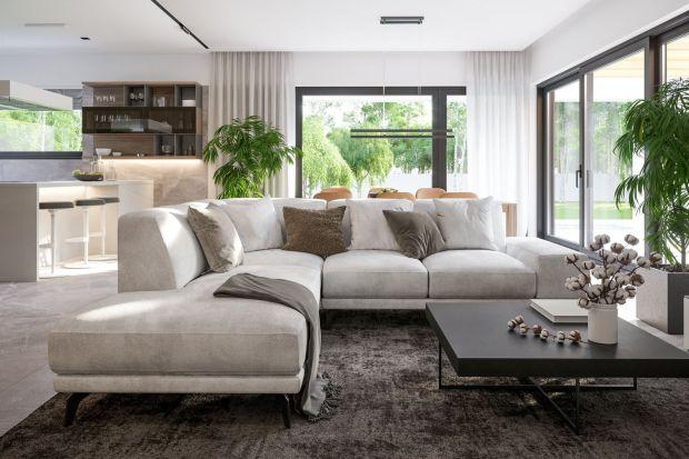 Nowoczesne wnętrza charakteryzują jasne barwy, duże przeszklenia i minimalizm w aranżacji. Takie właśnie jest wnętrze tego domu, w którym króluje naturalne światło.