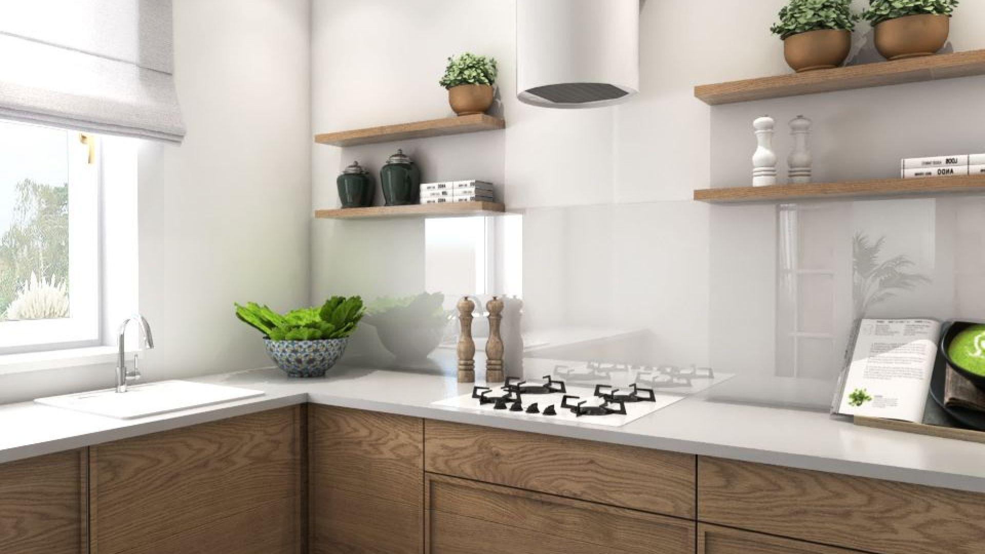 Póki zamiast szafek górnych eksponują naczynia, rośliny i dekoracje; dolna zabudowa, ułożona w kształt litery L, z frontami z drewna dębowego. Projekt i zdjęcia: Pracownia Architektoniczna MGN