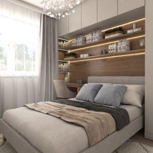 Łóżko obudowano z trzech stron. Przy oknie jest kącik do pracy i ścienne półki na dokumenty, przy drzwiach szafa. Projekt i zdjęcia: Pracownia Architektoniczna MGN