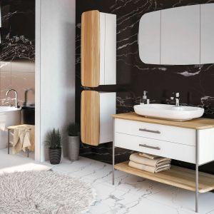 OVAL - serię wyróżnia charakterystyczny motyw przewodni formy z zastosowaniem różnych materiałów w połączeniu naturalnego drewna dębowego z metalowymi elementami malowanymi proszkowo. Dostępne w ofercie firmy Devo. Fot. Devo