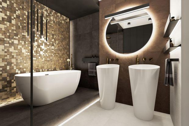 Stonowana łazienka została zaprojektowana dla młodego małżeństwa, które marzyło o własnej strefie relaksu przy sypialni. Ciemne kolory nadają jej elegancji i szyku. Prezentuje się pięknie.