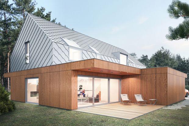 Projekt tego niedużego domu w formie nowoczesnej stodoły doskonale wpisuje się otaczający krajobraz.Maprostą, ale efektownąbryłę i piękne faktury materiałów elewacyjnych. Ale praca przy tym projekcie nie była łatwa.