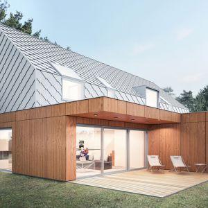 """Architekci zaprojektowali dom w formie """"nowoczesnej stodoły"""" z dwuspadowym dachem, postawiony na parterowym, drewnianym """"pudełku"""" z płaskim dachem. Projekt: Magdalena Gierczak, Zbigniew Gierczak"""