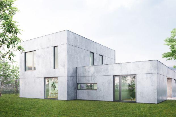 """Ten betonowy dom składa się z dwóch brył, """"pudełek"""" z płaskim dachem. Taki podział pozwolił uzyskać niewielką powierzchnię użytkową, zróżnicowanie elewacji i dobre wpisanie w działkę."""