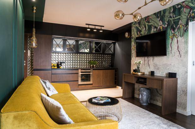 Mieszkanie o powierzchni 46 metrów kwadratowych ma wygodny układ funkcjonalny. Jest eleganckie, pełne mocnych, wyrazistych kolorów i niebanalnych wykończeń. Pięknie się prezentuje. Zobaczcie!<br /><br />
