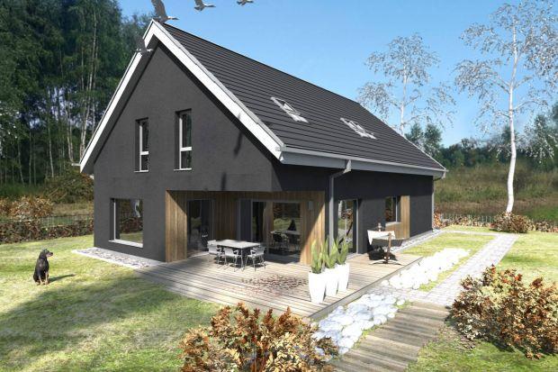 Ten projekt nowoczesnego domu z garażem, dwuspadowym dachem i obszernym tarasem powstał na działkę o powierzchni 1178 m2. Zobaczcie pomysł architektów z pracowni Studio BB Architekci.