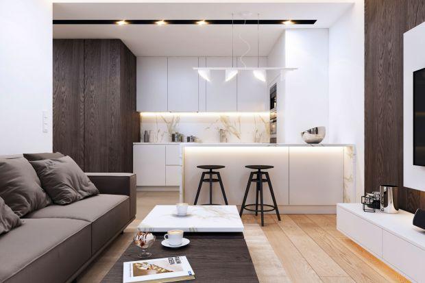To wnętrze, choć zaprojektowane w minimalistycznym stylu, jest ciepłe i przytulne.Efekt ten osiągnięto dzięki zastosowanym materiałom i kolorom. A zabudowa meblowa na zamówienie pozwoliła maksymalnie wykorzystać przestrzeń. Zobaczcie projekt