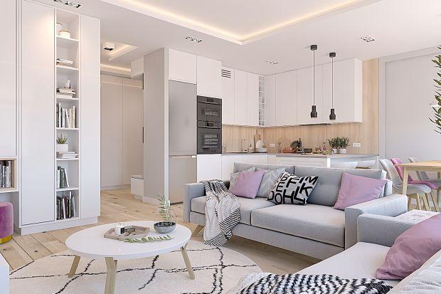 Biel i szarości, naturalne drewno, skandynawski styl i delikatne pastele - warszawskie mieszkanie jest pełne ciepła i bardzo przytulne. To projekt warszawskiej projektantki, Katarzyny Czechowicz.