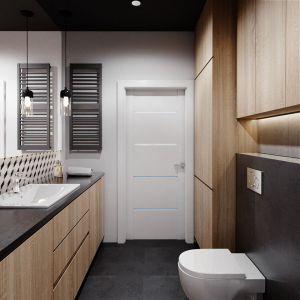 Zabudowa w łazience wykonana jest na indywidualne zamówienie (laminat w kolorze dębowym). Projekt Justyna Krupka, studio projektowe Przestrzenie