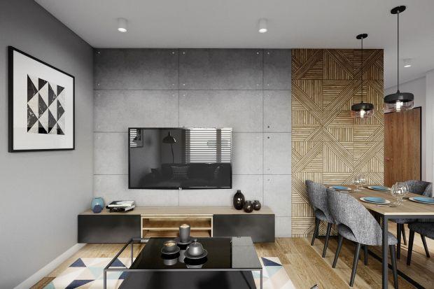 Ciekawyprojekt mieszkania dla rodziny z dzieckiem! Szara i grafitowa kolorystyka, naturalne drewno, inspiracje loftowym stylem - zobaczcie je koniecznie!